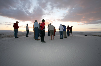 People gathered in deserted landscape